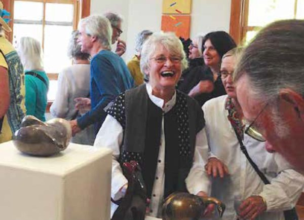 A group of people at a jovial gallery opening on Whidbey Island