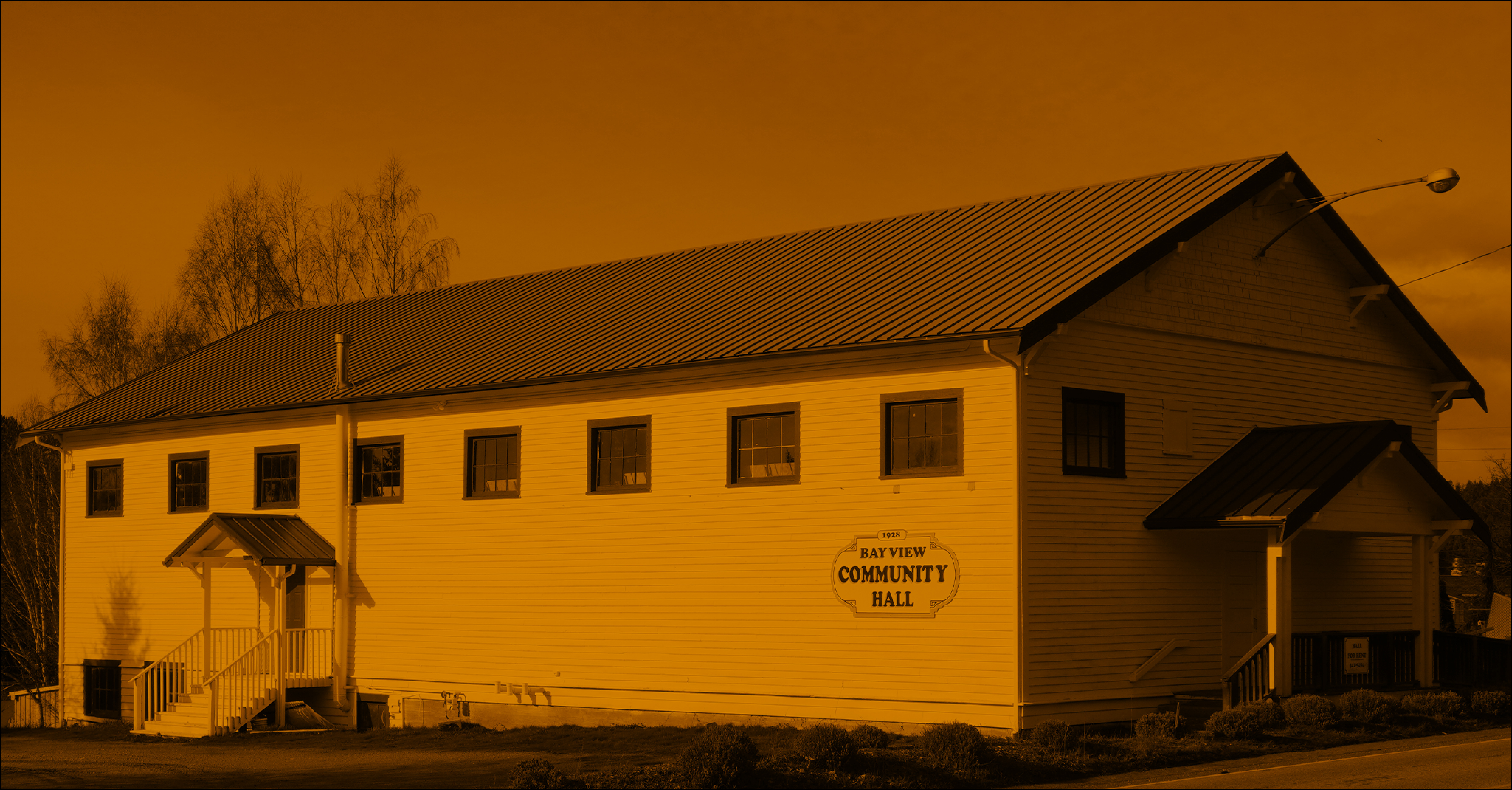 Duotone image of Bayview community hall in orange and black.